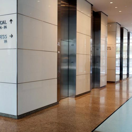 View of AGNORA supplied Insulated Glass Units & roller-coated back-painted glass for The Bow elevators