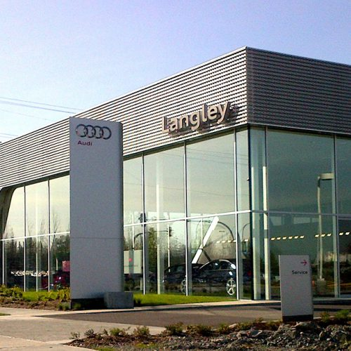 Exterior shot of Audi dealership featuring oversized, insulated glass units combining low-e and clear glass.