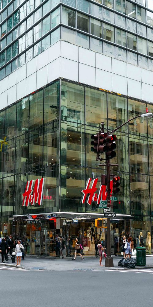 Across the street, corner view of H&M flagship store on 5th ave. Highlights the oversize laminated and insulated glass units.