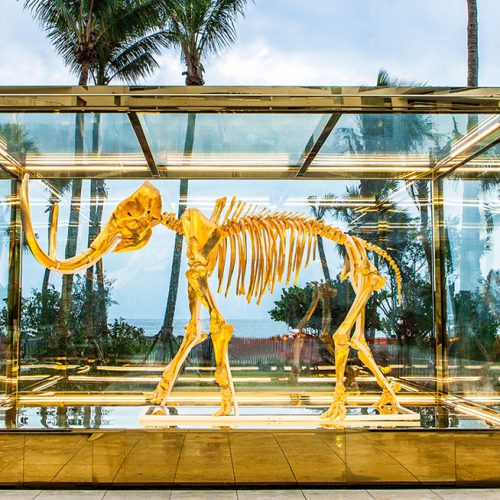 Gilded woolly mammoth encased in oversize insulated glass units