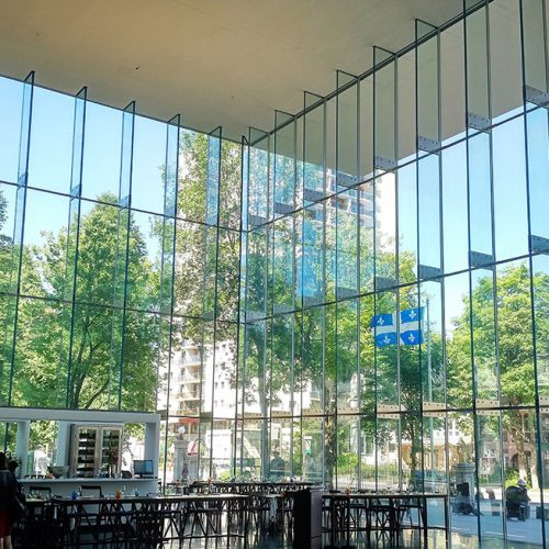 Interior view of Pierre Lassonde Pavillion, in the Musée des Beaux-Arts, showcasing 5-Layer Laminated Glass Fins