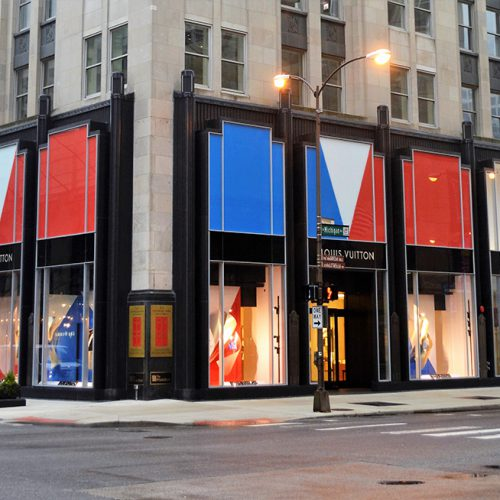 Exterior view of the Palmolive Building, featuring Louis Vuitton's storefront. with Oversize low-iron laminates