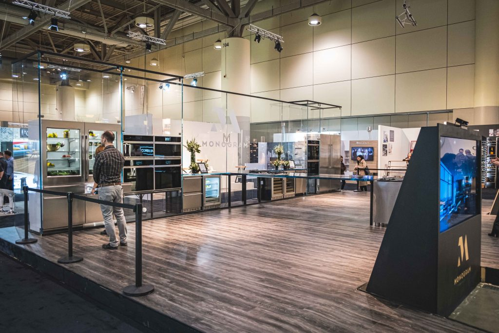 A full image of the glass exhibit, showcasing the size from the left side of booth