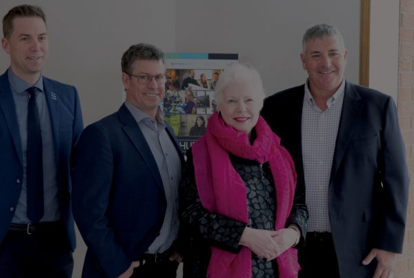 The Honourable Elizabeth Dowdswell and AGNORAs leadership team stand in the foyer of Agnora's Collingwood manufacturing facility